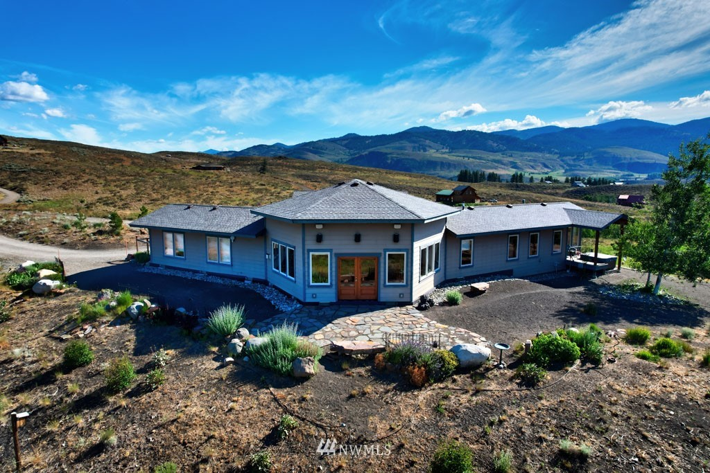 WINTHROP/Rendezvous:  Perfectly situated with 360° views of the surrounding mountains and Rendezvous valley.  Thoughtfully designed & custom built capturing the stunning views from every room.  3 BD, 1.75 BA home, 2,102 sf, on 19.95 acres, mudroom entry leads into the open hexagon shaped great room w/French doors opening to a stone patio.  Beautiful wood ceilings, wood floors, free standing propane stove, & large kitchen island with eating space.  Deluxe master suite, dual sinks, tile shower, walk-in closet, & sun room with private entry to the hot tub. Spacious laundry room & private office.  Attached single car garage connected via covered breezeway.  Enjoy the low maintenance landscaping allowing more time to relax on the large patio.