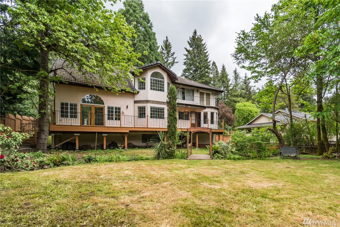 BELLEVUE SCHOOLS! INVESTORS' DREAM! Easy to update/remodel/expand on large level lot. Solidly built. Modern systems--newer gas furnace & ELEVATOR! Private, fenced backyard is great for large pets. Sunny bright interior in good condition. Big kitchen. King-size master w/walk-in closet, soaking tub.  Almost fully finished basement w/bath has separate entry--VACA rental? Home office? Guest quarters? 2-car attached garage. RV pkg. on big driveway. Close to Bus line/Beaches/Parks. Fast I-90 commute!