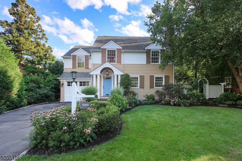 Immaculate Colonial in desirable Wychwood. 1st floor offers an elegant LR w/fireplace & FDR (currently used as playroom). Gorgeous center island kitchen w/2 sinks, SS appliances, breakfast bar & sep dining area w/banquet seating open to the step down FR w/lofty ceiling, wet bar w/bev. center, built-in media cabinet & French doors to back patio. A powder rm & laundry complete the 1st floor.  2nd floor MBR w/WIC, private bath w/steam shower & soaking tub; a BR w/en-suite bath, addl BR, bedroom/office & full bath. Third floor bedroom. LL rec room, gym & full bath.  For your comfort this home offers a whole house humidifier. Located in the heart of Wychwood on a beautiful lot w/covered front & side portico and expansive wrap around blue stone patio w/trellis, this lovely home is an absolute delight!
