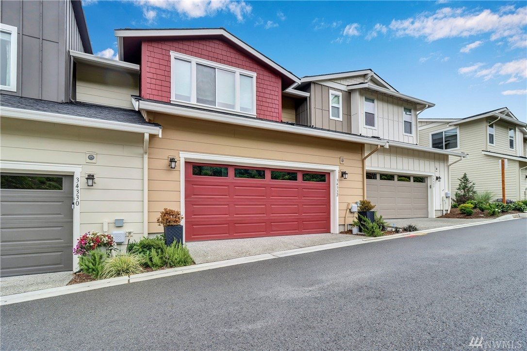 Looking for a Classy luxury townhome on the I-90 corridor w Astounding mountain views? This is the one! Coveted Snoq Ridge location & great layout make this home stand out. 3 Beds with 3.5 Baths + Bonus room,Trendy finishes & Sleek custom designs.Garage enters to main floor w Great room and Chef's kitchen. Upper holds an envious Master w Sitting room & Colossal shower and a 2nd Bedroom en-suite! Lower walkout has 3rd Bed w bath & Bonus room. 2 Decks. Parks & Rec all around & 30 mins to Seattle