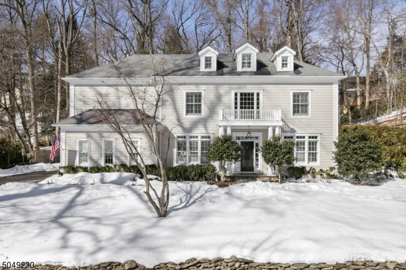 Beautiful newer Colonial with an abundance of space and light in the desirable Franklin School district. Perfect for entertaining and everyday living, the open floor plan features a dramatic 2 story family room with gas fireplace and soaring wall of windows. The home's high ceilings enhance the formal Dining Room, adjacent Wet Bar, and Living Room. A first floor Bedroom and full Bath round out this level. All 6 bedrooms with en-suite Baths. The 2nd floor showcases an enviable Primary Suite with luxurious Bath, enormous walk-in closet, and sitting area. Three more Bedrooms and two additional Baths (one Jack n Jill) are found on this level. The third floor contains a large Bedroom suite with Sitting Room and Bath, lots of storage and flexible space. Multi-purpose living areas are found in Basement's 4 rooms.