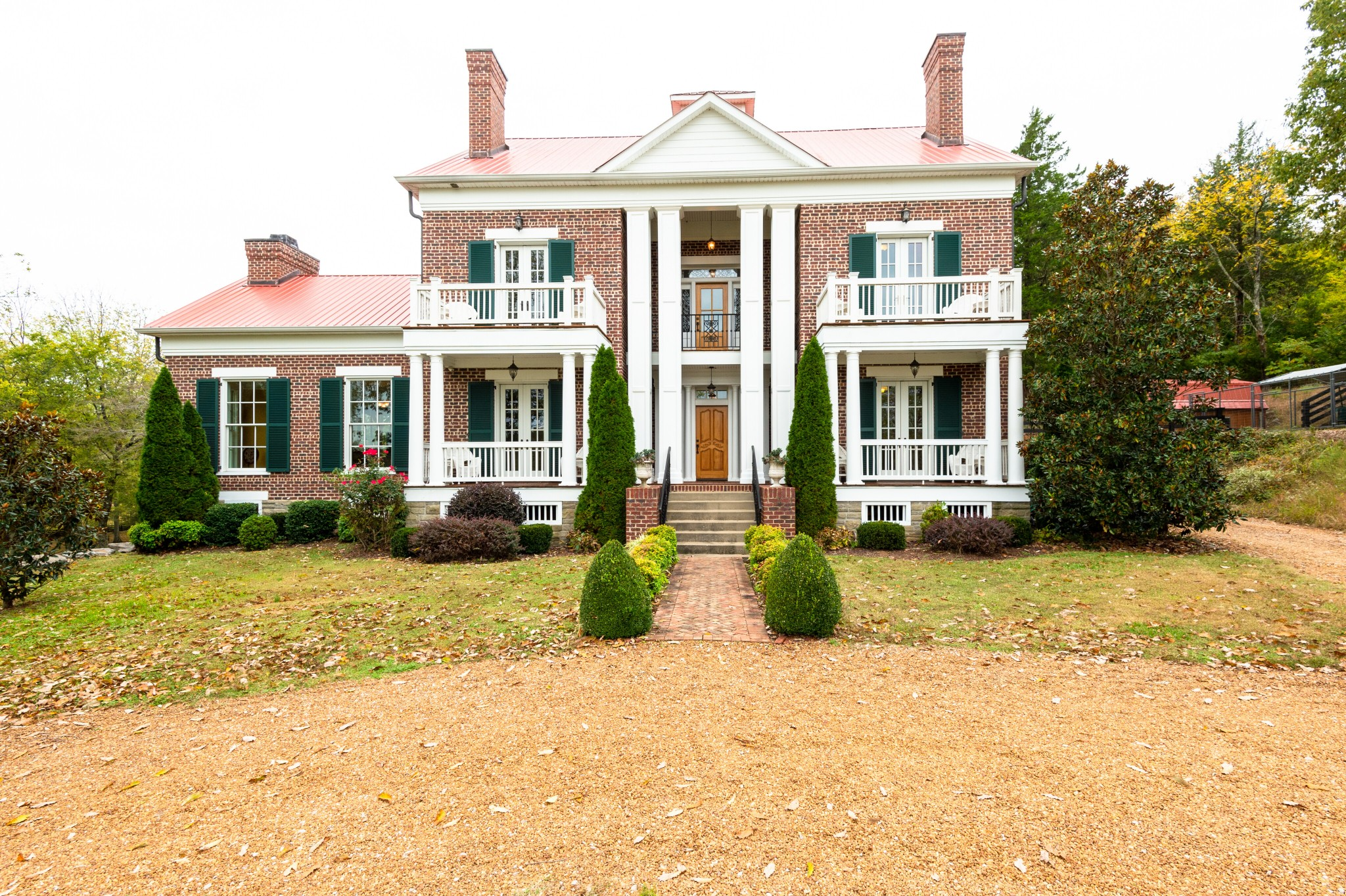 Spacious Greek Revival masterpiece perfectly set on 11.37 scenic Williamson Co acres. Real wide-plank hickory floors. 13 sitting porches! 1850s log home incorporated as kitchen with fireplace, brick floors & solid custom cherry cabinetry. Luxurious owner's suite has fireplace, private porch & newly renovated bath with custom glass shower. Stocked pond. 3 fenced acres in back. Heated/cooled dog kennel. Barn built to accommodate horse stalls or cars. Entertainment pavilion with storage.