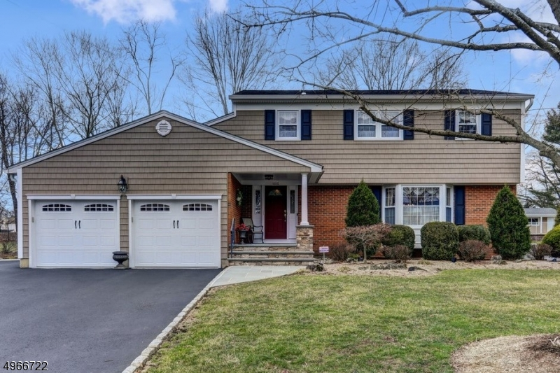 Beautifully landscaped colonial home, large rear deck w/built-in above ground pool perfect for entertaining. New energy efficient HWH,central vacuum, intercom system, oak Hwd floors, plus many extras. Spacious finished basement with bar, bonus room, large utility room and walkout. 2-car garage with loft area. Located on dead-end street, extra lot included.