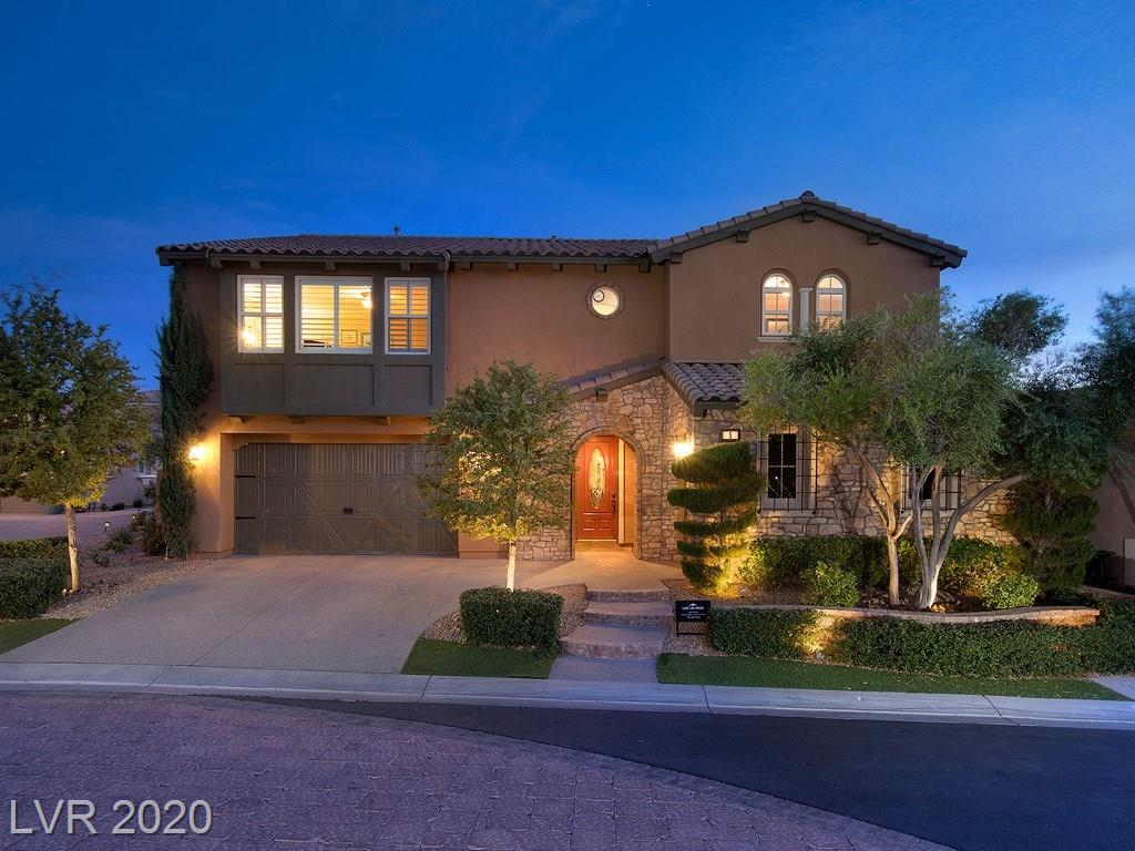 Stunning home in gated Lake Las Vegas / Back Yard resort with pool & spa / Built in BBQ / Gourmet Kitchen with granite counters & stainless steel appliances / Custom amenities & upgrades through out / High Vaulted Ceilings with sweeping grand staircase / Large bonus room / Shutters & Blinds / Tesla ready garage / Whole house venting system