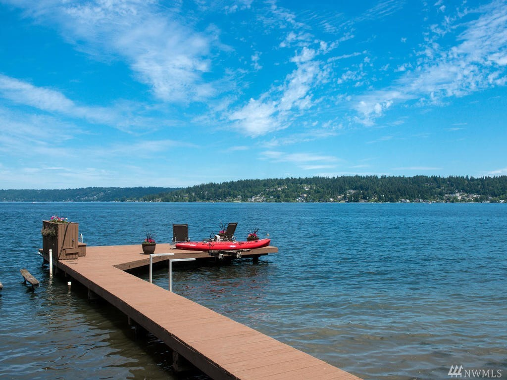 Rare opportunity to own a Bellevue legacy property on Lake Sammamish, boasting 156 ft of no bank, sandy beach waterfront w/ large private dock. Move in to beautifully maintained, mid-century rambler w/ original details, or build your dream estate on 1.58 acres of landscaped grounds. R-5 zoning w/ 7,500 min lot size creates an exceptional investment opportunity to create a signature waterfront enclave of luxury homes. Endless potential, just 2 min to I-90. Includes adjoining lot #1324059053.