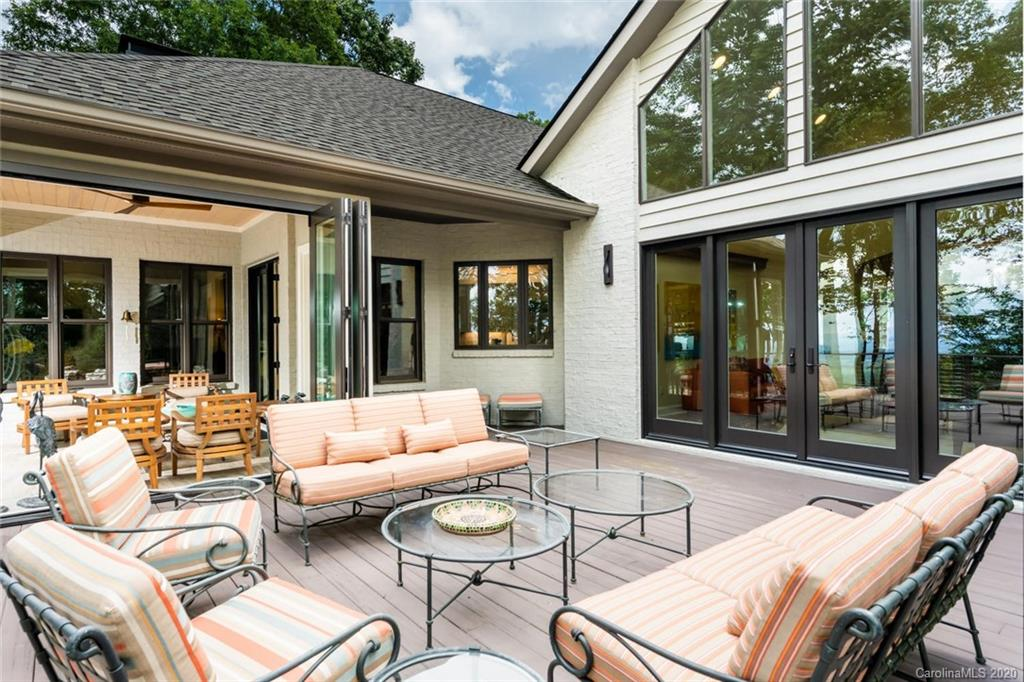 Exquisite Renovations! Absolutely stunning home w/ magnificent long range mountain views situated on 1.7 glorious acres. Renovated w/ high-end finishes throughout with over 3700 SQFT of luxurious main level living. Main level boasts open floor plan, Brazilian Cherry HWD floors, vaulted ceilings, wall of windows, great rm w/unique stone/slate fireplace, state-of-the-art gourmet kitchen, high-end appliances, open dining & breakfast area, family rm w/fireplace, built-in bookcases, study, den, spa-like master suite w/floating exquisite vanity, walk-in tiled shower w/ Kohler shower system, huge walk-in closet w/ built-in's, 2 guest BR's w/ Jack & Jill BA- would also make a great 2nd master suite w/ sitting rm, powder BA & laundry rm w/ Blomberg washer & dryer. The LL features a large family/rec rm w/ fireplace, bar area, wine rm, full BA, bonus rm & workshop area. Exceptional outdoor living- open deck space w/ cable railings, folding glass paneled sunroom & screened porch. AMAZING!