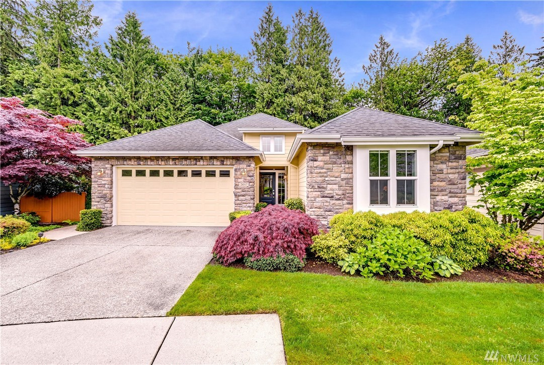 Pristine Whidbey model home loaded with upgrades and sited on a premium greenbelt lot awaits you. Great room design, with gorgeous hrdwd flrs connecting all the main living areas. Well-appointed kitchen w/granite tops, stainless appliances, under cabinet lighting & pull-outs. Lavish Owner's suite w/Spa-esque bath. Spacious den/Covered deck for year-round grilling/Backyard putting green/Stamped concrete walkways & patio. 240v plug-in electric car charger/Gas fireplace & custom built-ins. WOW!