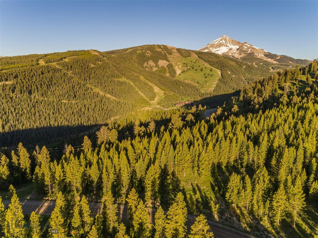 This 20-acre parcel includes several incredible view options based on chosen building site location including Spanish Peaks, Lone Mountain, and the Big Sky valley. The gently sloping lot has Southern and Eastern exposure while enjoying privacy, abundant wildlife viewing, nearby access to Lee Metcalf Wilderness and Gallatin National Forest, and is just minutes from Town Center and Big Sky Resort. Nordic ski-in/ski-out on Lone Mountain Ranch XC trails that cross the corner of the property and wind through Lost Trails, connecting residents to dozens of miles of groomed trails. The region is renowned for enjoying the outdoor life, including the Gallatin National Forest, Yellowstone National Park, and top notch fishing, hunting and more. Lost Trails owners share a community water system, and electricity is underground to the lot. Don't miss this special opportunity to live your Montana dream in a private, quiet setting, while being close to all of the area's amenities.