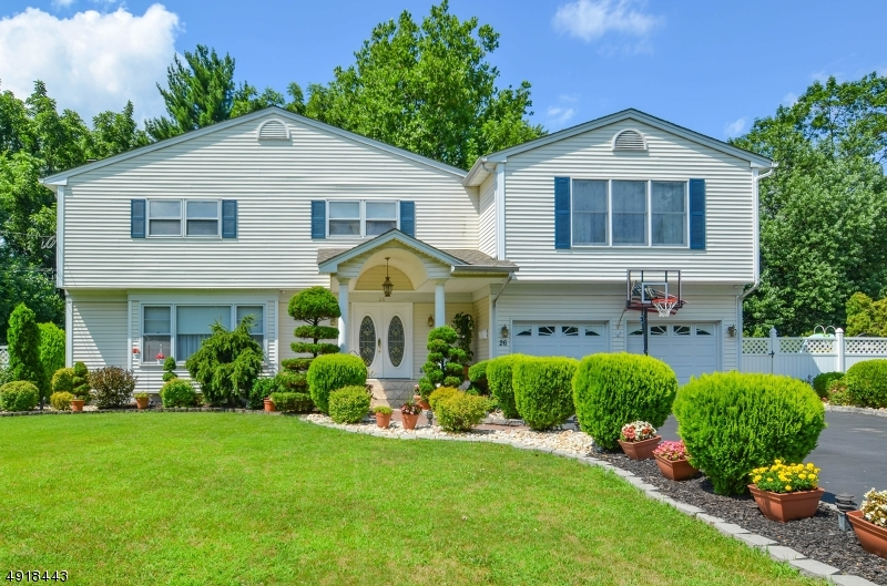 Stunning 5 BR, 3 full bath home located in the highly sought after Clark, NJ. Spacious, bright and newly updated with a FULL IN- LAW SUITE! Well maintained & ready for a new owner! Sunken FR, formal DR. Tons of potential for multi family living, Full in law suite with LR, KIT, MSTBR w/private balcony, full bath & laundry area. 4 additional BRs including a second MSTBR w/en suite. Private, outdoor oasis is the perfect place for all of your summer gatherings! 20x40 in ground pool, tiered deck with hot tub, koi pond, professional landscaping, 2 car garage & 9 car driveway!