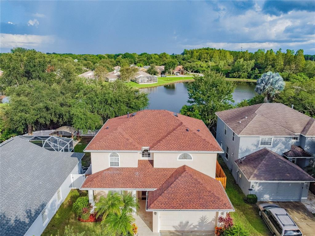 ***Multiple Offers received and the deadline for all offers are by 8p on 9/19***  Rarely Available and Dazzling Floridian Dream Home in Tampa! Picturesquely nestled on a sizeable 6,534sqft lot in the highly desirable area of Carrollwood, this 4BR/3BA, 3,000sqft split-floorplan property mesmerizes with delightful Mediterranean architecture, lush landscaping, and welcoming sidewalk-lined streets. Once inside the immaculately maintained interior you discover gleaming engineered hardwood floors, towering foyer ceilings, an organically flowing floorplan, a neutral color scheme, a flood of luminous natural sunlight, thick white crown moulding, a gorgeous staircase with wrought iron spindles, and a massive living room. Designed with entertaining in mind, the open concept kitchen features stainless-steel appliances, smooth granite countertops with matching backsplash, custom wood cabinetry, recessed lighting, pantry, gas range, built-in microwave, dishwasher, and an adjoining dining area. Enjoy the sprawling backyard, which has an expansive greenspace, a tranquil lakeview, and tons of room for grilling and chilling. Sleep easy and retire to the impressive primary bedroom with large closets, an intoxicating lakeview, and an attached en suite with a deep soaking tub, separate shower, and a dual sink storage vanity. Two guest bedrooms are abundantly sized with dedicated closets and may be ideal for overnight visitors, children, or home offices. Suitable as an accommodating mother-in-law suite, one additional primary bedroom is located on the first floor and includes an en suite. Other features: attached 2-car garage, laundry room, newer roof (2019), great room and loft w/lake views, updated bathrooms, no CDD, low HOA, close to shopping, restaurants, schools, entertainment, and cafés, and so much more! With so much to offer, this turnkey home will go quickly. Call now to secure your private tour!