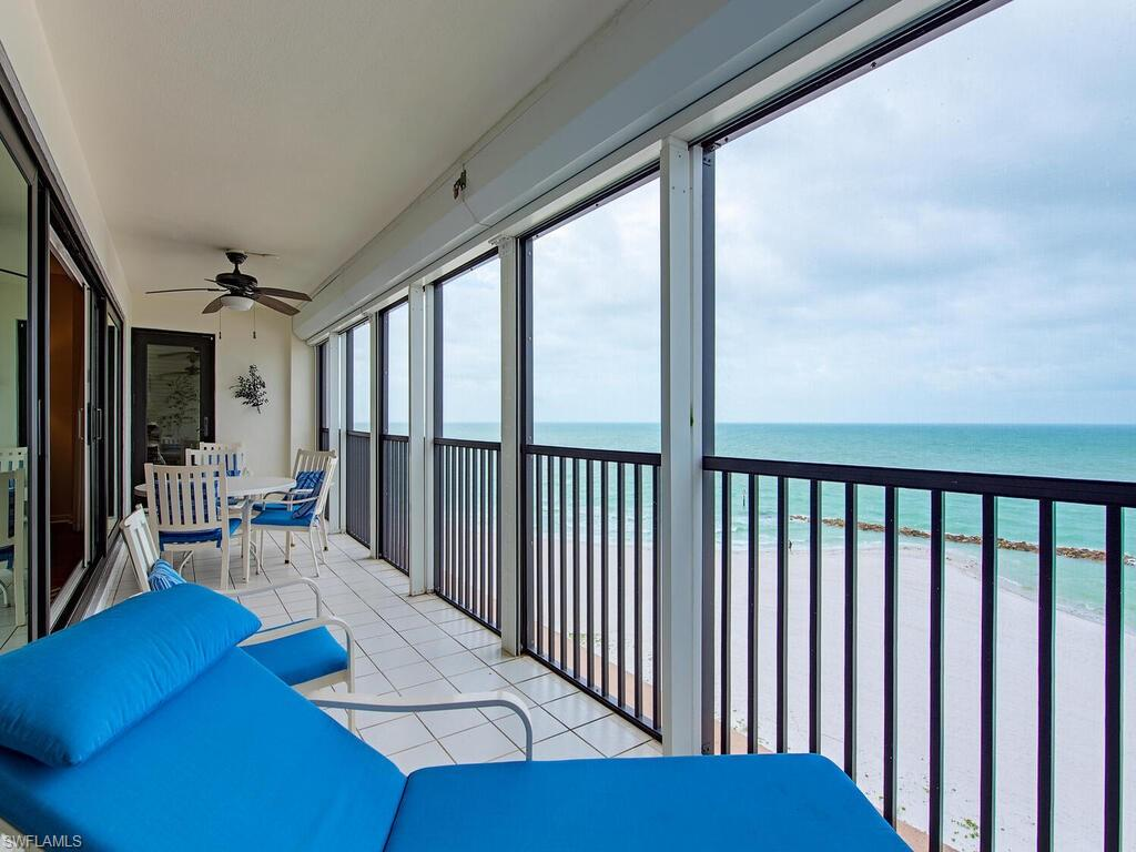 With panoramic views of the Gulf of Mexico from every room, this 2 bed 2 bath condominium offers a quiet paradise retreat with the comfort of ocean sounds.  Located on a private and highly desirable area of the Moorings, units are rarely available. This quaint 2,018 sq ft beachfront condominium is located on the popular access point of Gulf Shore Blvd North near Doctor's Pass. Complete with impact glass windows and sliders, wood flooring throughout the condo, spacious living/dining area and full length west facing balcony features electric roll down hurricane shutters for added security. Amenities for this 55+ community include a newly renovated fitness center, entertainment room, heated pool, beach access, paddle board/kayak storage.