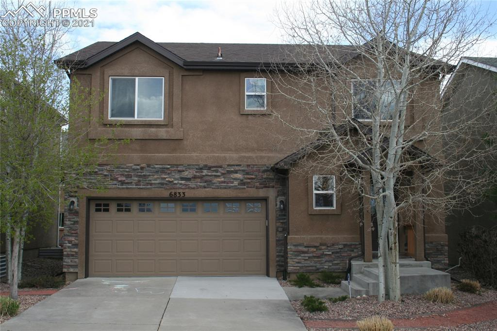 Fabulous 4/4/2 home in the Powers corridor with easy access to Ft Carson, Peterson, and Shriever. Located on cul-de-sac and near schools and shopping. Prior model home with many upgrades. Granite and stainless kitchen with wood floors, and fireplace in the living room. Enjoy the huge master suite with two-sided fireplace to sitting area (or nursery/office) with beautiful Pikes Peak view! Heated floors in master bath! Two other bedrooms with jack-n-jill bath and laundry upstairs. Granite in bathrooms and upgraded fixtures.