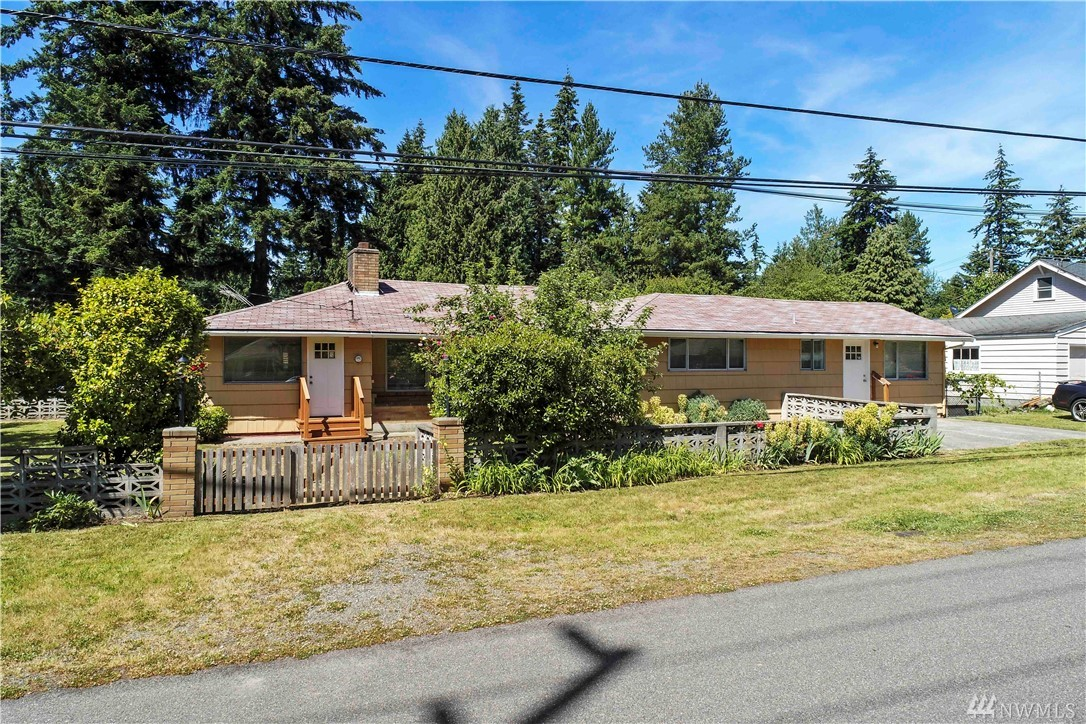 Come see this tastefully updated home: new appliances, paint and floor coverings with adjoining 1 bedroom, 1 bath, living room and kitchen. 2 car carport plus off street parking. Fenced back yard. Great location, close to shopping and commute corridors. Zoned MUR35