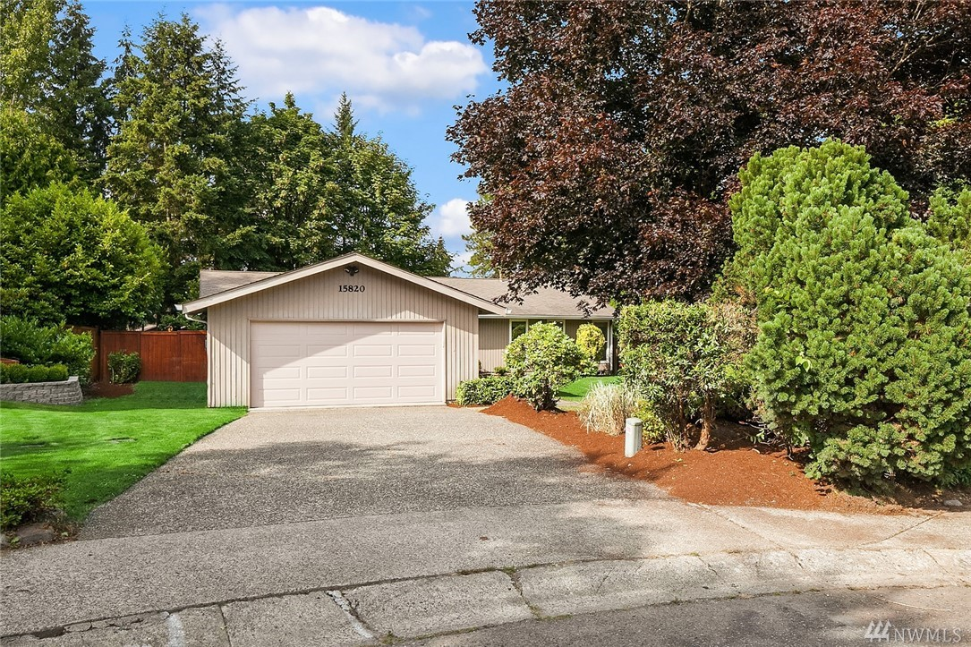 Completely updated rambler in the sought after Tamarack Lane neighborhood, minutes to Microsoft! Over 2,000 SF of one level living featuring brand new floors, fresh paint, granite counters & SS appliances. Spacious living & family rm w/ double sided fireplace, dining rm w/ wet bar & sitting room that opens to the deck & huge backyard! Master en-suite, plus 4 bedrooms including guest suite w/ 3/4 bath. Private fenced in 13,000+ SF lot in cul-de-sac, blocks from Microsoft, 520 & lightrail.