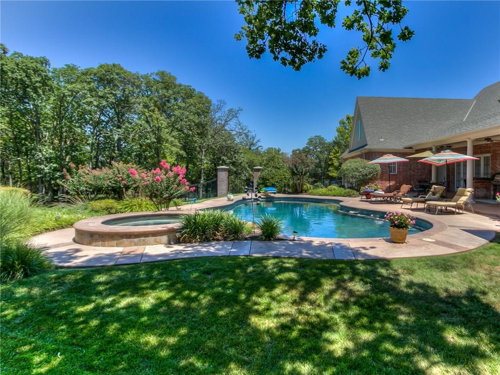 Classic Southern Beauty, this home offers all the charm and privacy of country living, with only a few miles commute to I-35, and minutes from Edmond downtown. Detailed craftsmanship, wonderfully maintained and over one acre! You'll love the chef's kitchen, butler's pantry, granite counters, double oven, oversized island, pantry w/ breakfast bar and storage galore. Enjoy morning coffee in the sun room or on the side terrace both with a breathtaking views. The great room has window walls that bring in the outdoors and beautiful view of the backyard oasis. Upstairs has three bedrooms, two baths and large bonus. Formal Dining with lots of space and a stately fireplace at the head of the table. The study/office has rich built-ins and a fireplace. Master closet has an additional safe room/cedar closet Enjoy the outdoors entertaining spaces: pergola with fireplace, 9Ft. diving pool, hot tub, water feature, outdoor kitchen is under the covered main patio with eating bar. Don't miss this one!