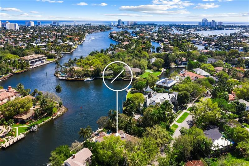 """Villa Vista"" sits grandly where the New River & the Tarpon River converge providing EPIC panoramic views along its 100' of river frontage. Mediterranean-style estate built in 1926 was substantially renovated in 1989. Cathedral wood beamed ceilings welcome you to the living areas w/gorgeous keystone fireplace, wood floors, french doors opening to private courtyards and patios. Kitchen updated by current owner offers top-of-the-line appliances including gas cooktop. Master suite w/sitting area encompasses second floor & overlooks the river & pool w/private balcony to enjoy the glorious boat parade! Office & 3 bedrooms (one ensuite) on the first floor, w/powder room, large laundry room, generous storage areas & a two car garage with high ceilings. It's a pleasure to show this classic estate!"