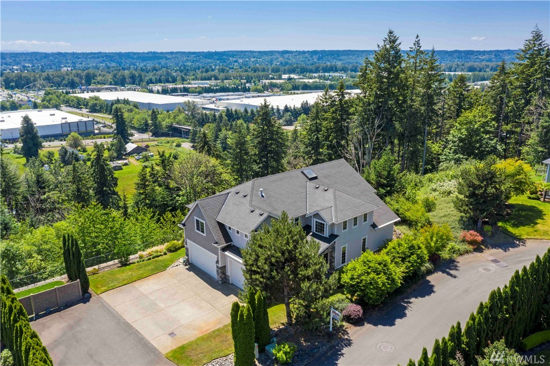 Tucked away on a private cul de sac in convenient Edgewood, this stunning property offers privacy & beautiful valley views~Impressive covered stone entry leads into foyer, formal living & dining rms w/soaring ceilings, gleaming hardwood floors, lots of windows~Great rm w/cozy gas fireplace, flowing into kitchen w/newer stainless appliances, granite, island & eating area~Enjoy views from the covered back patio & most rms~Exquisite vaulted master ste w/views~3 car garage~Mature landscape~Sprinkler