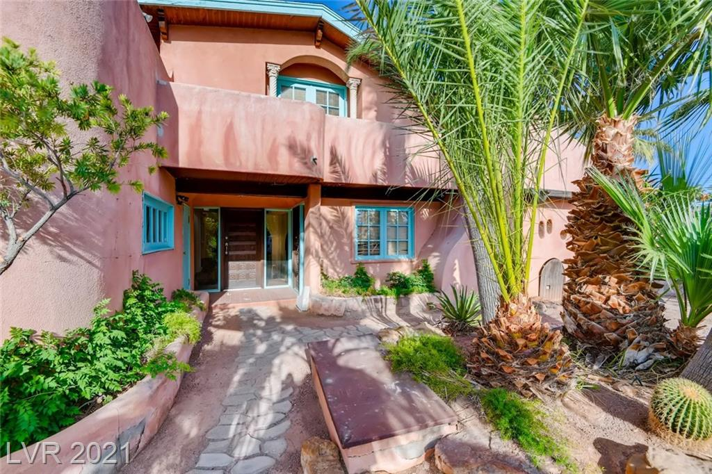 Semi-Custom Mediterranean style home with rounded ceilings and arches.  Upstairs den/office with strip view.  Salvaged beams from former Dunes casino.  Great location near community park.   Easy access to the airport and 215 freeway.   SOLD AS IS. WHERE IS  NO WARRANTIES.