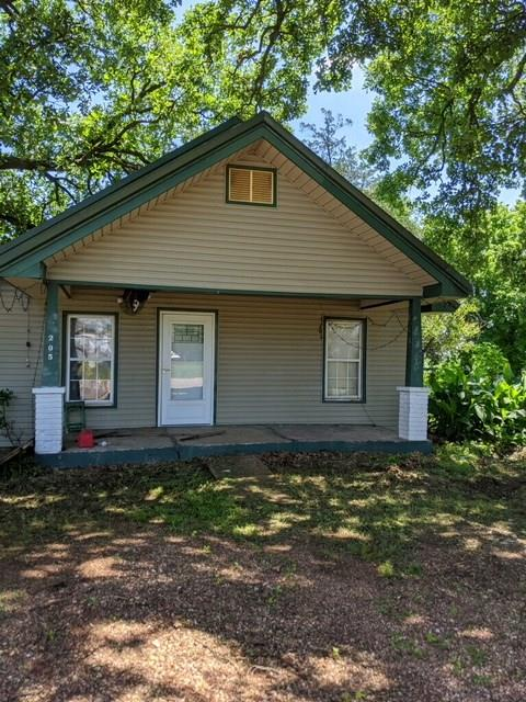 Calling all Investors!!  Home on large lot with a 40x60 workshop with 2 overhead garage doors.  The shop has heat and electricity.  Also a guest house in the back of the house that could be rented for extra income.  House and shop have good bones but just needs some TLC.  Great pontential.