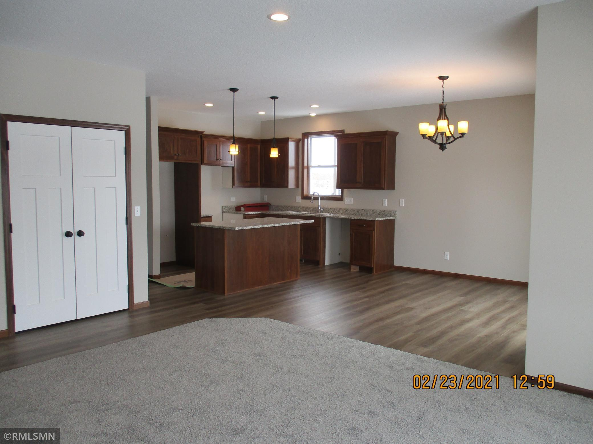 New Construction Granite counters thru out, custom cabinets with kitchen island, unique floor plan, concrete drive, $100 association reserve required at closing