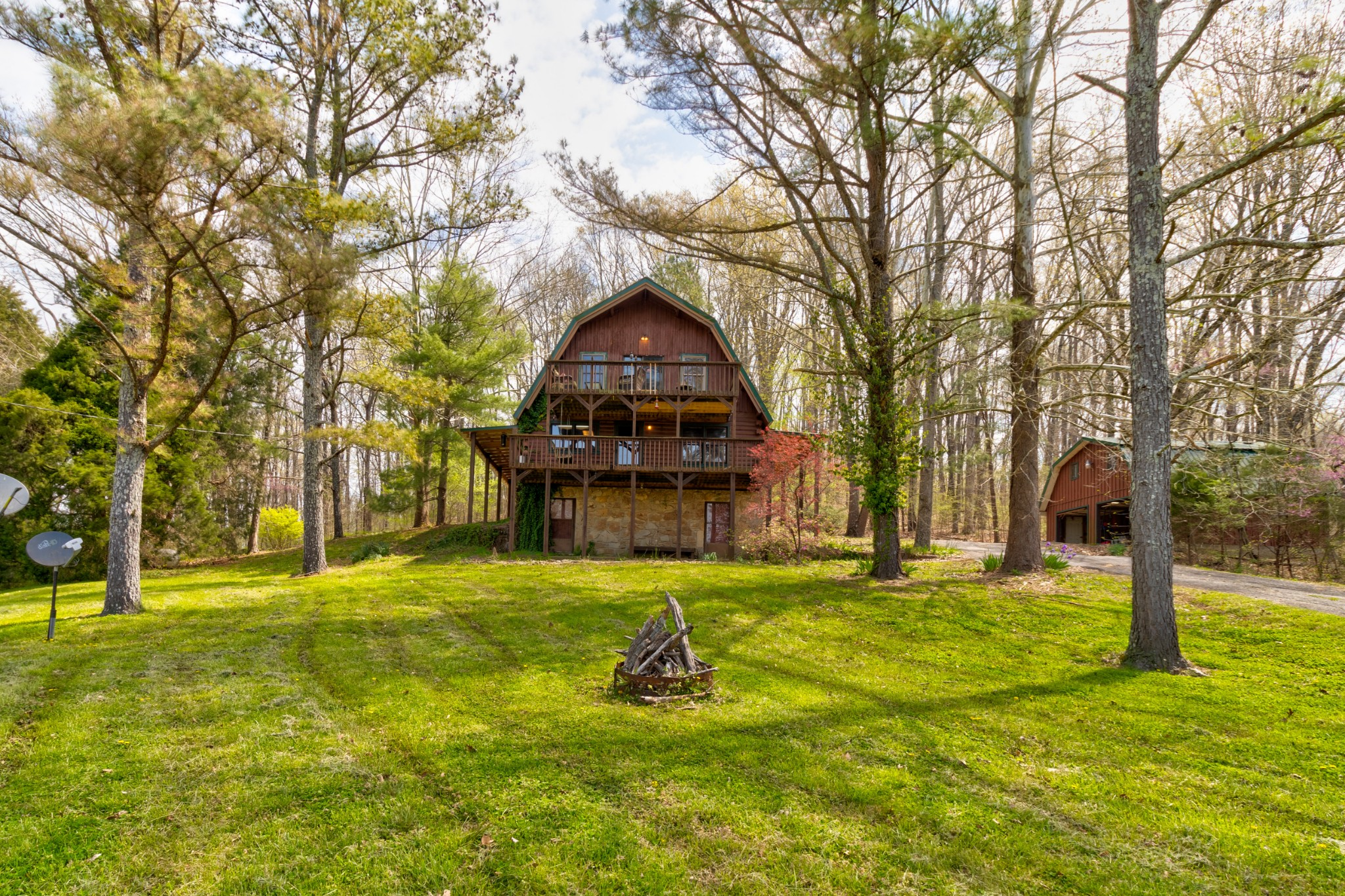 Get away from the hustle and bustle of downtown Nashville and check out this charming log home in Columbia, TN! This charming 3-story home boasts 3 bedrooms and 2.5 bathrooms. It also rests exclusively on 21.58 acres of land; perfect for camping and enjoying the outdoors! You'll love the beautiful views of this secluded, country-living cabin!