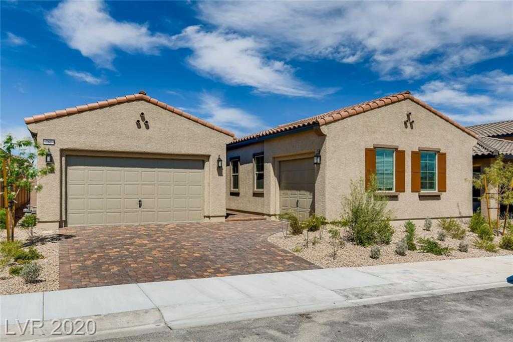 "Heritage at Cadence, premier age-qualified, guard-gated community in Henderson! Gorgeous single-story home. This home includes our ""Everything's Included"" features such as GE kitchen appliances, 2"" faux wood blinds, Home Automation, USB outlets at kitchen & master, and much more!"