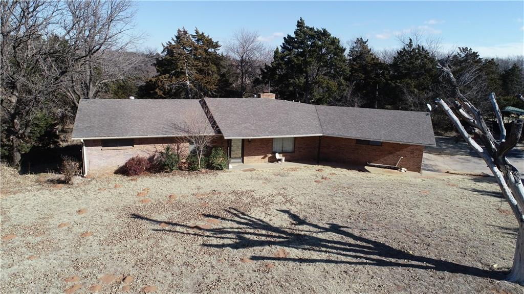 Welcome to country living on  the edge of Weatherford nestled by a creek view, open floor plan, Walk out basement, sunken living area, brick features in the kitchen,  large closets in the  large bedrooms .This home is on 2.9 acres.  Lots of wildlife with this location.