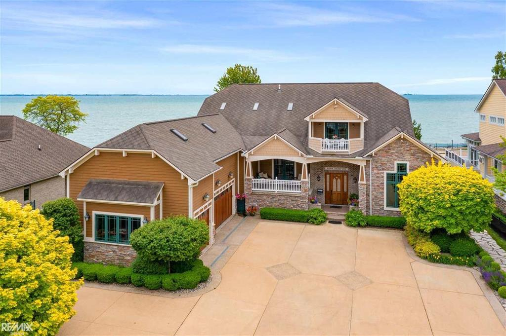 STUNNING LAKEFRONT ONE OF A KIND HOME W/TOP OF THE LINE FEATURES!! 100 FT. OF FRONTAGE ON 1/2 ACRE LOT ON LAKE ST. CLAIR! 4 BEDRMS, LIBRARY, 4 FULL, 2 HALF BATHS, 4 SEASON RM & MUCH MORE!! KITCHEN HAS 2 DISHWASHERS, THERMADOR APPL, DOUBLE OVEN, ISLAND, BAR AREA & WALK-IN PANTRY. AWESOME 1ST FLR MASTER SUITE! UPSTAIRS BEDRMS WITH PRIVATE PATIO & AMAZING LAKEFRONT VIEWS! 3RD BEDROOM HAS ITS OWN BATH & STORAGE RM. BONUS RM OVER GARAGE, WIC IN ALL BEDROOMS, JACUZZI TUBS, TIGERWOOD FLRS THROUGHOUT 1ST LEVEL, CUSTOM DOORS, UPGRADED TRIM, 1ST & 2ND FLOOR LAUNDRY RMS, GRANITE COUNTERS, CERAMIC TILE, FORMAL DIN. RM, BUTLER?S PANTRY, FIN. W/O BSMT HAS 9 FT. CEILINGS, FULL KITCHEN, BATH, WINE CELLAR, EXERCISE RM & ENTRY TO GARAGE, OVER 8,000 SQ. FT. INCL W/O BSMT! 3 FIREPLACES, 3 FURNACES, NEW SWIMMING POOL (2018), GENERATOR (2015), 2 NEW HWH (2016), CENTRAL VAC, SPRINKLER SYSTEM, SUMP PUMP W/WATER FLOW BACK-UP, SECURITY & SOUND SYSTEMS, 3+ CAR GARAGE W/LIFT & WORKSHOP. LIVING RM TV & SWING EXCL.