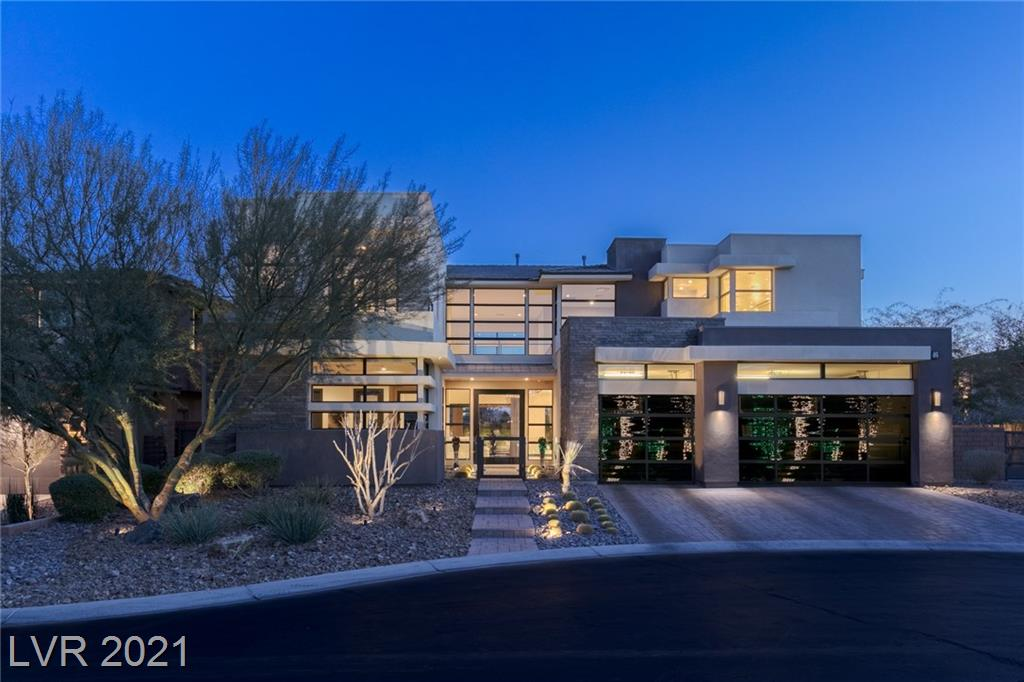The Epitome of Luxury Living! Highly upgraded semi-custom 2-story w/exceptional mountain views, superior privacy, & unparalleled amenities. Desert contemporary/modern finish w/8' glass entry door, custom stonework, upgraded flooring & countertops, & much more. Smart home features include whole-home sound, intelligent thermostats, motorized shades, & 8-camera surveillance system. Great room w/22' ceilings, white glass wet bar, 378-bottle wine wall, & 20' wide glass pocket doors to patio. Eat-in kitchen w/Thermador appliances. Rear yard w/stainless outdoor kitchen, fire pit lounge, & zero-edge pool/spa/wet deck w/state-of-the-art pool equipment & color-changing lights. Spacious office w/corner pocket doors that open to pool deck. Primary bedroom up w/incredible mountain views, 2 large closets w/custom cabinetry, counter-to-ceiling mirrors, Da Vinci bathtub w/in-ceiling faucet, & rainfall shower w/benches & body jets. 3-car garage w/epoxy floors & tinted glass doors.
