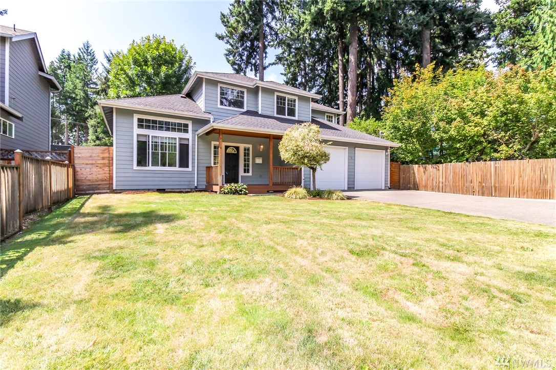 This gorgeous custom built home in Fircrest has 3 bedrooms plus a large master with french doors and 5 piece en suite.  The soaring cathedral ceilings, Italian inspired cable lighting, attic fan, and oversized garage are just a couple of the amazing extras this home has to offer.  Relax in the cozy family room with gas fireplace or hang out on the huge back deck. The fully fenced backyard has a beautiful garden space, grape vine trellis and 220 outlet for a hot tub. This home has it all!