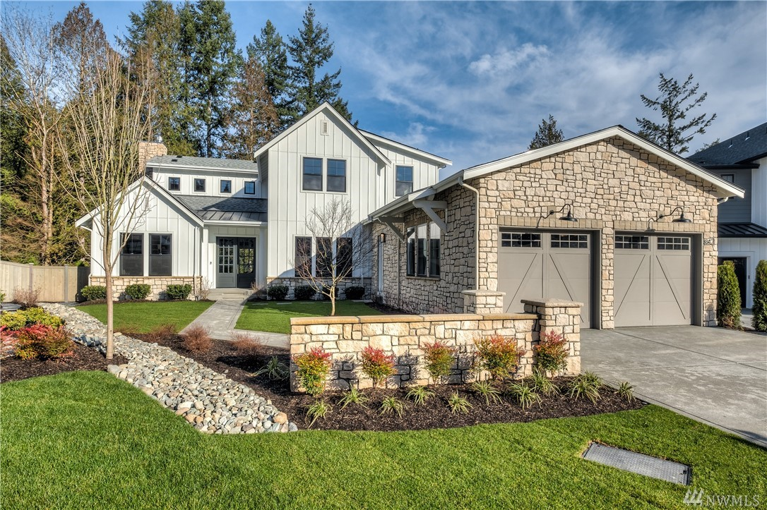 Experience the next level of NW Farmhouse living. Each feature has been thoughtfully selected by design experts to please the most sophisticated of tastes. Situated in a quiet cul-de-sac overlooking treed protected space, this special home boasts master-on-the-main w/fireplace & spa bath, guest suite, formal dining, office w/built ins & 2 story great room w/soaring ceiling. Thermador professional kitchen appliances, custom cabinets. Covered deck w/FP; Leading edge HomeSmart® technology included.