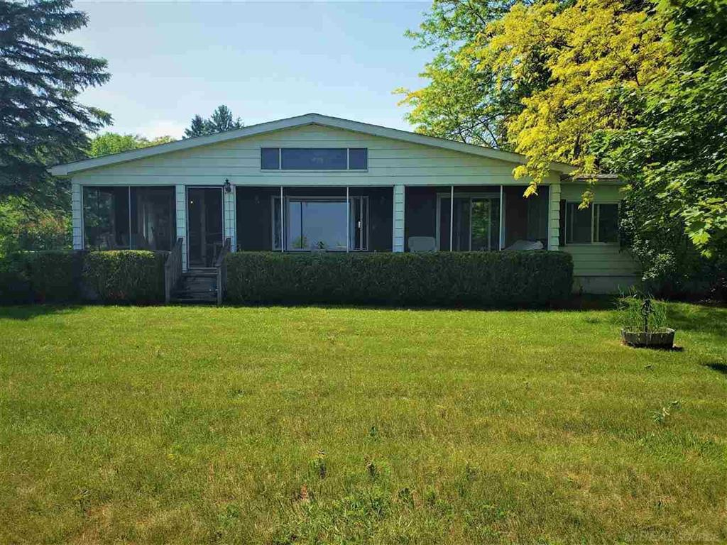 Attention lakefront buyers! Here it is, just what everybody is looking for? An affordable, clean, move in ready lakefront home under $300,000.00. This ranch styled manufactured home was built in 1976. It includes 2 bedrooms, 1 1/2 baths, & features 75 feet of gorgeous Lake Huron frontage. Enjoy lake views relaxing in the living room or in the 8 X 37 ft. screen room facing the lake. Outdoors, there is a 1-1/2 car detached garage, paved drive, & beautiful property perfect for outdoor fun!  Brush on the bluff needs some trimming. Older stairs to the lake may need some maintenance, however, with a little TLC this can be your dream home! Do not let this amazing opportunity pass you by? Stay on the lookout for open house notice or schedule a private showing today!