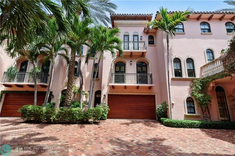 Luxury townhome located within blocks of Las Olas Blvd shops and restaurants. This expansive and open 3 bedroom, 3.5 bath townhome has marble flooring throughout,  a private elevator, designer touches and impact windows. The second floor with your main living area includes your kitchen with a gas range cooking island, dining area, a wet bar , ample seating for entertaining and double french doors to your balconies.  The third floor is dedicated to your private master bedroom suite with two walk in closets, a large master bath and balcony. The two guest bedrooms and baths are located on the first floor with a two car garage.
