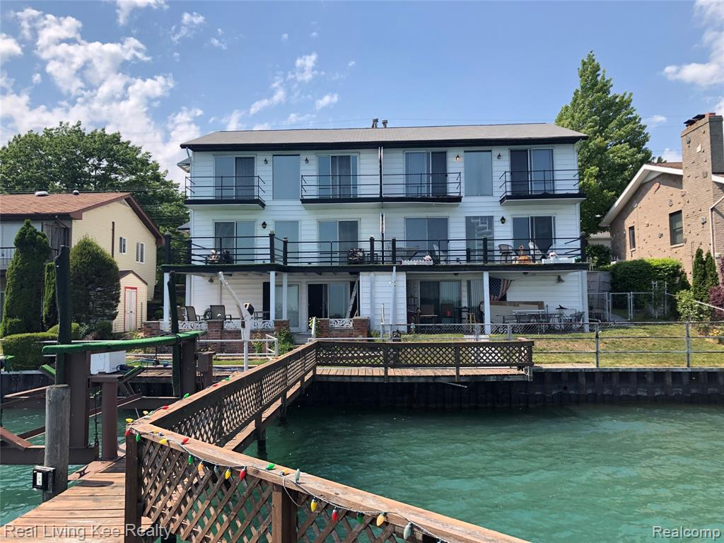 """Wonderful views and waterfront living opportunity. Fantastic year-round or vacation home. Two second floor ensuites each with vaulted ceilings, full bath and door wall to their own balconies. Main floor offers kitchen, eating area and living room all with wonderful views of the beautiful St. Clair River, your shared dock and private boat well with boat lift. Lower level is finished, with kitchenette, half-bath, laundry room and is a great place to entertain, tell fish stories or relax while watching a ball game while the cool breezes blow in from the river on a hot summer day.    This is a two-unit condominium and is not """"warranted"""" by FHA.  Traditional mortgage financing may not be available.  If financing is going to be used to purchase one should check with their local or regional lender on the availability of financing.  HOA of$200 is an ESTIMATE...3218 Military was owned by the brother (now deceased) of owner of 3220 Military...the owners would split expenses."""