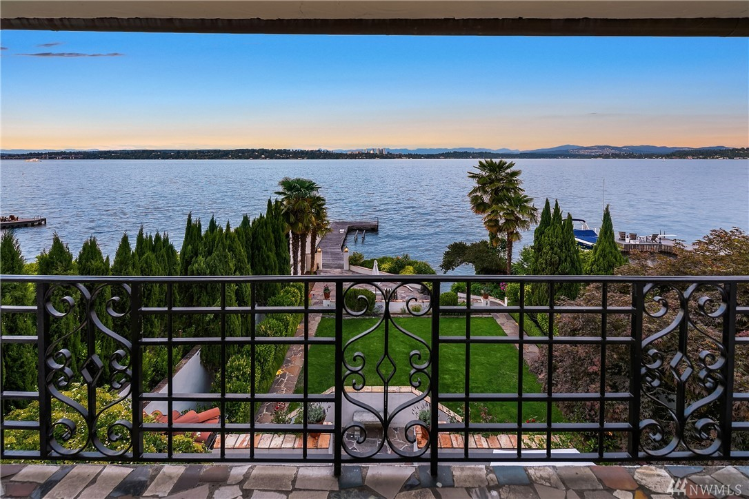 Santa Barbara meets Seattle on the western shores of Lake Washington. 4,300 sq/ft on 3 levels and 44' of waterfront creates a mesmerizing experience year-round. Unprecedented privacy is provided from property's tasteful landscaping. Views showcase Mount Rainier & Downtown Bellevue. A new spa-like master suite provides luxurious space for relaxation. Terraced gardens & a grass lawn provide gracious spaces for entertaining. Home includes outdoor BBQ & shower, indoor theater room & wine cellar.