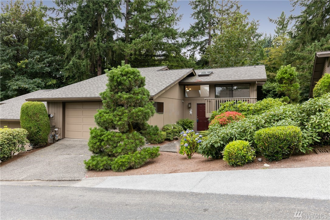Best deal in the neibourhood! Lovely 3 Bedroom in Desirable HideAway! Easy access to free way, close to Bellevue DT, waterfront, Park. TWO Master Suites with Private Decks Overlooking Protected Greenbelt.Vaulted Ceilings,huge skylight bring in a lot sunshine. New roof, Newer Cabinets, Granite Counter tops, Stainless Appliances. Upper Master Has Huge Jacuzzi Soaking Tub.Enjoy the Peaceful Setting from any 1 of 3 large decks. RV PARKING.Award winning Bellevue SD.