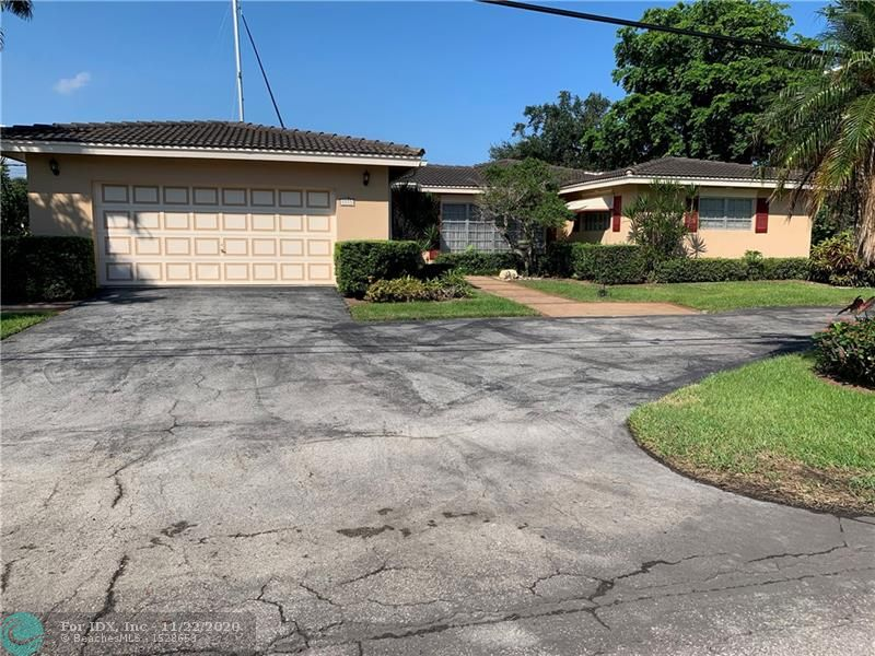 Located in Beautiful Rio Vista this Large 3 Bedroom / 3.5 Bathroom Ranch house boasts 124 Feet of Deep Water!! The Oversized Lot is perfect for your Large Yacht! Set on a wide Canal just moments to the Intracoastal with easy Ocean Access.  The interior of the house could use updating but it has a great open floor plan with large bedrooms and walk-in closets, 2,705 sq.ft. under air. Very nice mature landscaping surrounds the property with good sized patio and Large Pool.  Or if your looking for a Large Lot to build a New House this property has an awesome Canal Basin View with the Downtown in the background!  The property is Aggressively Priced Under $2 Million allowing for a Remodel or New Construction.