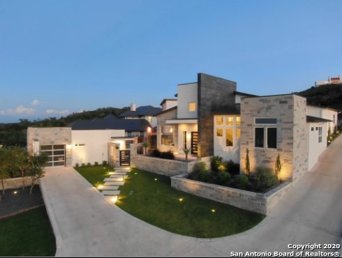 2017 Parade of Homes contemporary luxury hillside estate. Award-winning elevation with north hill-country views. Open transitional floorplan, vaulted ceilings, 8' doorways, custom cabinetry, Italian tile, & Complete Home Automation. Modern kitchen opens to Lg living with glass fireplace & hill country views. Master suite with pool/courtyard access, panoramic views, sitting area, grand walk-in closet, serene bath & Lg garden tub. Custom pool w/hot tub & infinity edge. Detached MIL suite. Fenced-in flat bkyd