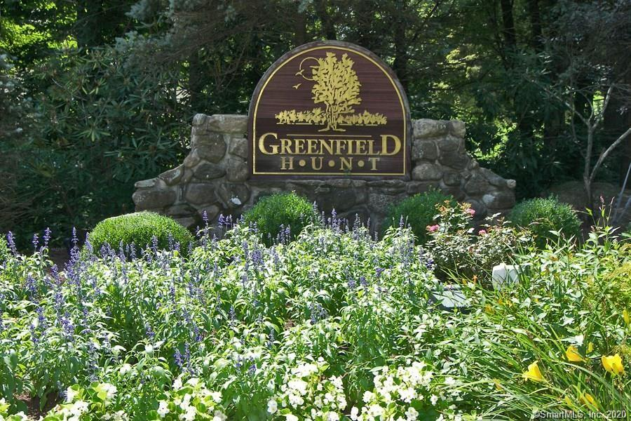 Greenfield Hunt!  The best of both worlds!  This is a freestanding colonial home in a condominium association with 100 homes.  An instant neighborhood for you without the hassle of exterior maintenance and with the bonus of a pool and poolhouse.  But because all of the homes are free standing, there are no shared walls, no lack of privacy.  Eaton Court is a small cul de sac complete with visitor parking, in addition to the two car garage with two more spots in front, and with plenty of space between neighbors.  Sit out on your back deck and enjoy the privacy!  Inside you have four generous bedrooms and two full baths upstairs and an open concept first floor - the open kitchen/family room everyone wants, in addition to a living room, dining room, powder room, and mudroom/laundry.  The lower level is partially finished with an additional family room, bringing the total finished square footage to 2900. Plus there's an additional 434 square feet in a partially finished storeroom/mechanical room that you can enjoy as is, or use in a different manner.  Life is easy at Greenfield Hunt - in today's busy world, do you really want to waste your time cutting the grass?  Simplify your life.  Enjoy! Covid Protocol will be observed - masks, gloves, and booties are required to be worn in the house.  Please stay away if you have been exposed to Covid in the last two weeks or have come from a state which has restrictions in CT.