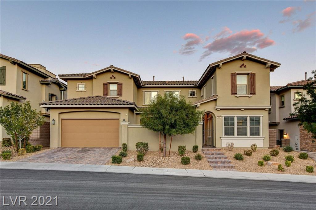 Beautifully apoointed home in West Summerlin...better than new with over $100,000 in Builder upgrades. Open...Bright...Indoor & Outdoor Living...180 degrees of Strip & Mountain views from 2nd floor Balcony off Loft & Bedrooms. Front, gated courtyard with gas firepit...Backyard covered Patio...extended glass doors to front & back outdoor areas. Gourmet Kitchen offers GE Monogram Stainless Steel Appliances, extended Kitchen Island, upgraded cabinets, Hanson quartz counters, custom backsplash, extended sidebar counter & cabinets. Wood floors enhance living areas. Custom paint throughout. Bedroom & full Bath on 1st level separate from living area. Master Bedroom offers Strip view. Master Bath upgraded with Lanai Shower.  Laundry Room upstairs includes sink, cabinets & shelving. 3 car garage with Mud Room entry to house. 10+++