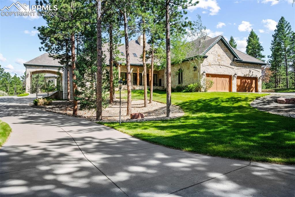 Located in the desirable gated community of Majestic Park. Pristine Pikes Peak Mountain Views. 10,880 square feet of luxury living space. The masterfully designed estate is situated on an unbelievable 35 acre lot in a subdivision bordering the 1 million acre Pike National Forest. Stone porte-cochere & impressive 16' arched double entry doors. Coveted amenities & inviting outdoor spaces set the stage for Colorado living at its finest. The light-filled great room is a thing of beauty, marked by exquisite custom alder millwork, nano doors that open to patio & a stately floor to ceiling wood burning fireplace. Nearby gourmet chef's kitchen is appointed with rich custom cabinets, built in refrigerator plus 2 refrigerator drawers, 2 freezer drawers, a warming drawer, wine cooler, copper sinks, trash compactor & expansive granite island. Host a dinner party with ease in the formal dining room with limestone fireplace & nearby butler's pantry with ice maker.  Luxurious master suite with two fireplaces & adjoining sitting room. Spa-like master bath affords a soaking tub, walk-in shower, two walk-in custom closets connected by a cedar closet. Five main floor guest rooms each with ensuite bathrooms. The expansive family room is the entertainment hub & showcases a custom bar, ice maker, wall of windows & double doors looking out to the Ponderosa Pines, terrace & lush lawn. 2 separate home offices and a quiet retreat room for reading or TV. Relax in front of one of the impressive stone fireplaces or catch a quick workout in the fully-equipped home gym – here there is something for everyone & entertainment options to suit every mood without ever leaving home. Outdoor living is abundant from the covered terrace & in-ground fire pit – ideal for grilling out & watching the seasons change. Built for effortless indoor-outdoor entertaining, this home is the perfect choice for buyers looking to move right in & start living the Majestic Park lifestyle today.