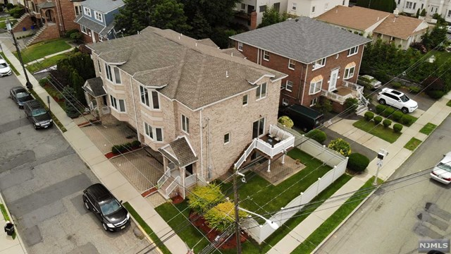YOUNG WELL MAINTAINED ALL BRICK DUPLEX FEATURING AN OPEN AND AIRY MAIN LEVEL WITH 9FT HIGH CEILINGS, SPACIOUS LIVING ROOM WITH GAS FIREPLACE, FORMAL DINING ROOM, MODERN EAT-IN KITCHEN WITH BROOKHAVEN CABINETS AND STAINLESS STEEL GE APPLIANCES, AND PRIVATE DECK WITH STAIRS TO YARD....MASTER SUITE WITH TRAY CEILINGS, TWO WALK-IN CLOSETS AND MASTER BATHROOM COMPLETE WITH GLASS ENCLOSED SHOWER STALL AND JACUZZI TUB...TWO ADDITIONAL WELL APPOINTED BEDROOMS AND FULL BATHROOM IN HALLWAY...GROUND LEVEL FINISHED WITH TWO CAR GARAGE, RECREATION ROOM, HALF BATHROOM, AND SLIDING GLASS DOOR TO PATIO FENCED IN YARD....ADDITIONAL FEATURES INCLUDE OVERSIZED ANDERSON WINDOWS, OAK HARDWOOD FLOORS THROUGHOUT, POURED CONCRETE FOUNDATION, MULTI-ZONE HEATING, 5 TON A/C, AND MUCH MORE....ALL WITHIN WALKING DISTANCE TO SCHOOL #1, LEWIS COLE MIDDLE SCHOOL, LIBRARY, PARKS, AND DOWNTOWN FOR SHOPPING, DINING, AND ENTERTAINMENT. NJ TRANSIT LINE 159 IS LOCATED RIGHT ON CORNER.