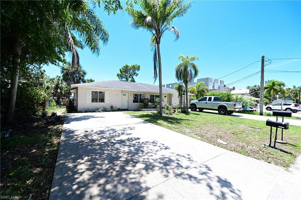 Fantastic opportunity to own this South facing Gulf access duplex on a wide canal where you can walk or bike to  beautiful Bonita Beach. This duplex sits on a 75'x135' lot and can be used as a highly desirable rental, as a home site that can accommodate a large single family home or build two attached 3 story villa homes for your self or as spec homes and provide rental income while you design a home(s). Each unit features two bedrooms and one bath. the left side has just been updated (appliances on order).   The right side has a month to month tenant and is in good condition.  Direct Gulf of Mexico access by boat is 10-15 minutes to the North or South and the beach is only 3/4 of a mile away. Don't miss this opportunity to own a great waterfront investment property.