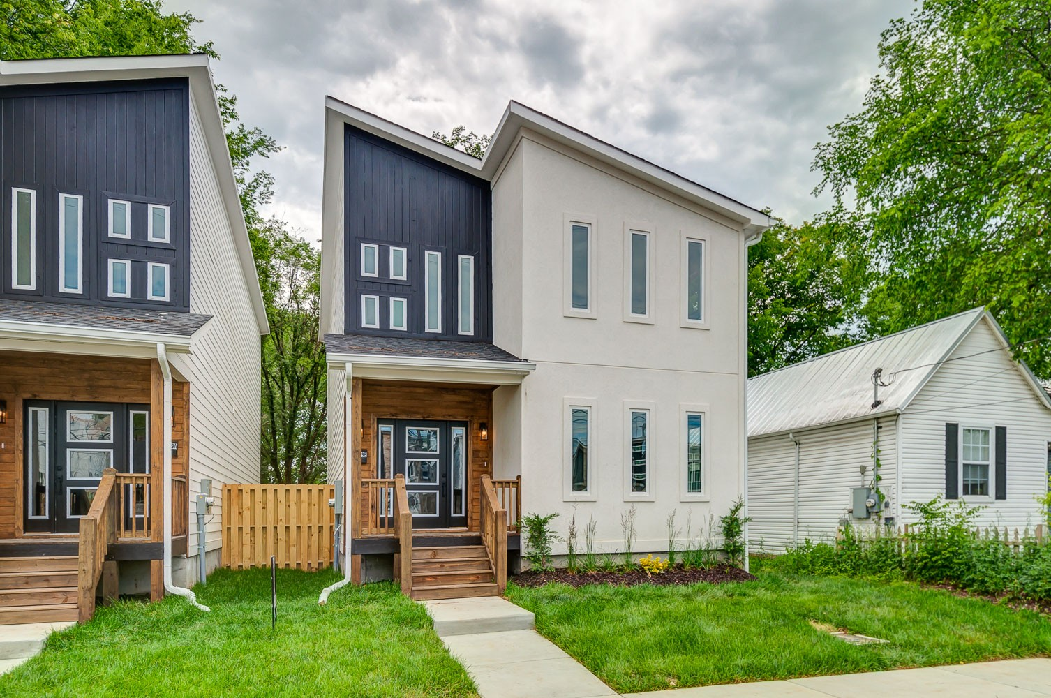 Stunning modern new build close to FARMER'S MARKET, DOWNTOWN, and GERMANTOWN. Location and design make this gorgeous home a must-see. Alley access parking pad and GARAGE!  Photos are from staged unit next door.