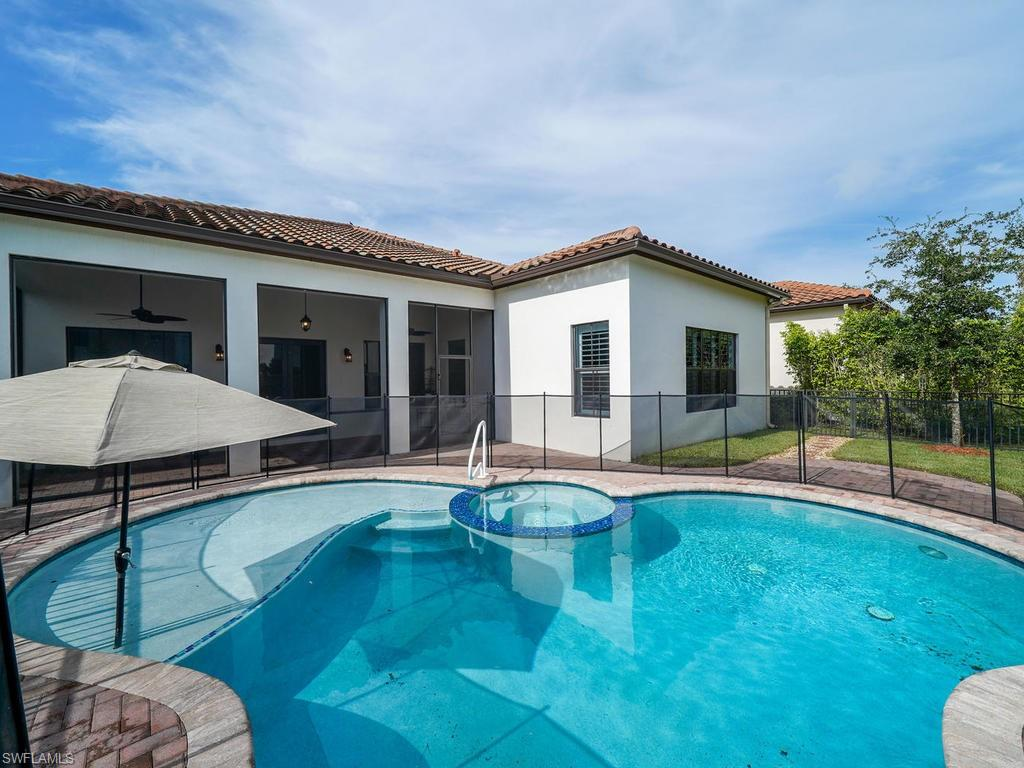 "H.13440 - Entertainer's delight!  This 4/3, ""Briones Model"" with over $130,000 in upgrades is a rare gem!  Single story, 2 car side entry garage with a private heated pool/spa (tanning ledge/ sun shelf in pool) with a privacy wall.  A chef's dream! High-end upgraded kitchen with 42"" inch wood cabinets w/rope crown molding, granite countertops, backsplash, under-lighting, pot rack over island, and extra storage (under cabinets) in kitchen.  Porcelain tile in living area, crown molding throughout, window treatments, garage door opener keypad & upgraded faucets throughout (Moen & Kohler). Upgraded washer/dryer with cabinets storage and laundry room sink. Stunning Master bedroom upgrades include custom closets, plantation shutters, frameless shower, tile to ceiling in shower, upgraded wood vanity cabinets, large soaking tub and porcelain plank tile. This gorgeous and lovingly maintained home is walking distance to Town Center, dining, Publix, Ave Maria amenities, playgrounds, parks, walking/jogging trails, dog park, fitness center, tennis courts, bocce and more.  Come experience this one of a kind home in Ave Maria's award-winning neighborhood Maple Ridge. New Club House!"