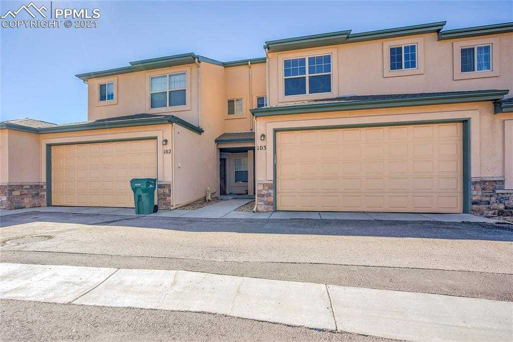 Updated 3 Bedroom, 4 Bathroom Townhome centrally located in the Rockrimmon area with a 4th bedroom/office possible.  Gorgeous mountain views with walkout family room in the basement, storage, 2 car garage, and wood floors throughout the main level.  The EaglePointe complex offers an exercise room, pool, and recreation/community center close to hiking and biking trails, shopping, hospitals, and so much more.  District 20 schools to top it off!  This home is a MUST SEE!