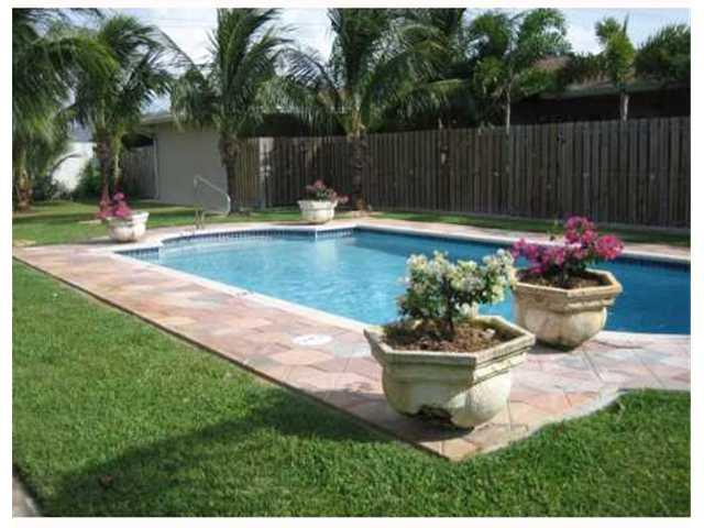 Stylish 1/1 condo in popular secure pool complex seconds from Wilton Manors and minutes to the beach, downtown and US-1! Maple cabinet, stainless appliancs and granite counters in kitchen. Marble floors throughout and front and rear fenced courtyards for each unit. The condo is poolside and their are on site laundry facilities. Impact windows. Pets allowed.