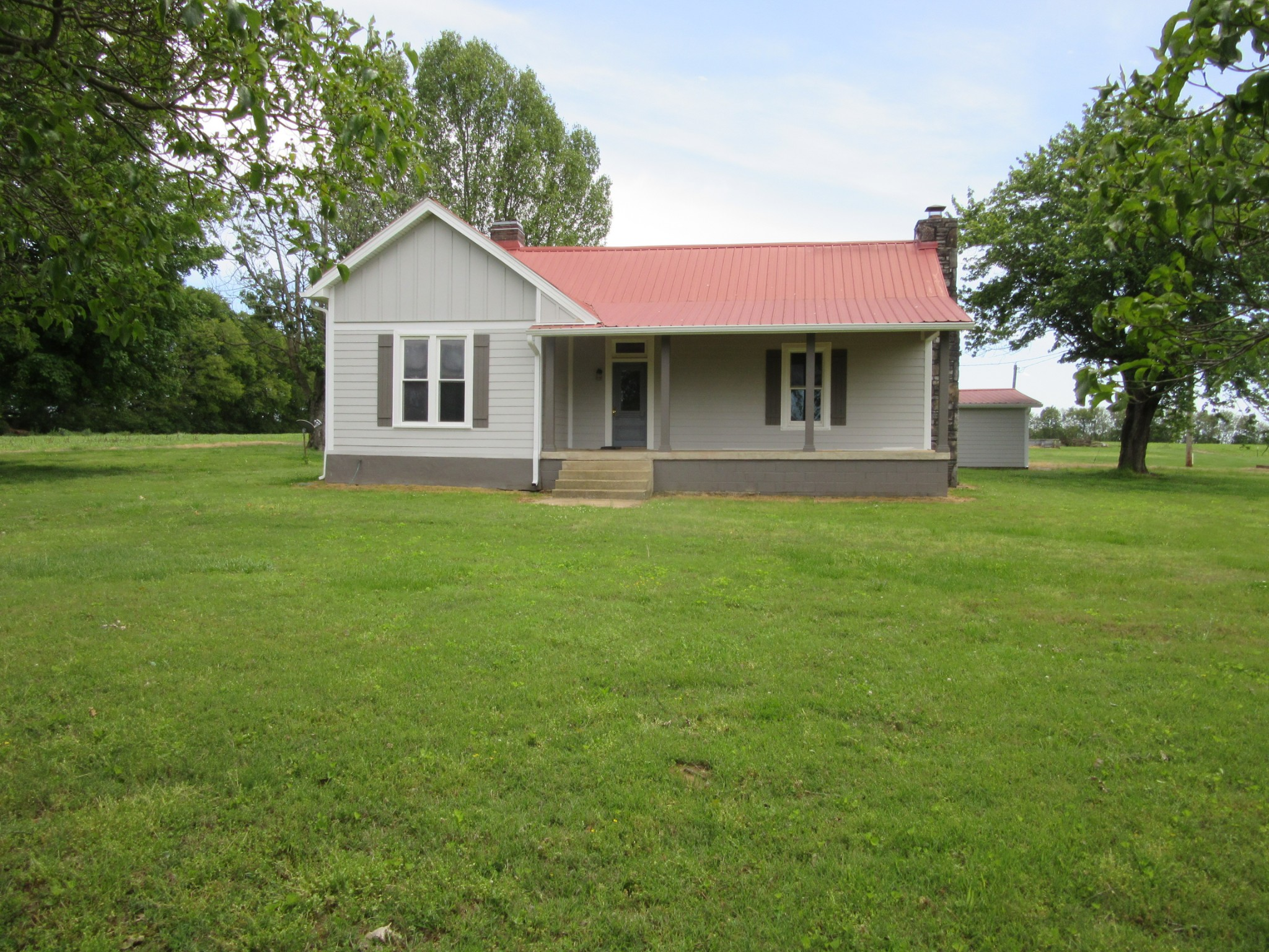 Beautiful Country Farm Home on 2.8 acres, Large Rooms with 2 Car Attached Garage and Shop Building with Peaceful Country Setting, Peach Trees, Apple & Pear Trees Surrounded by Corn and Soybean Field.