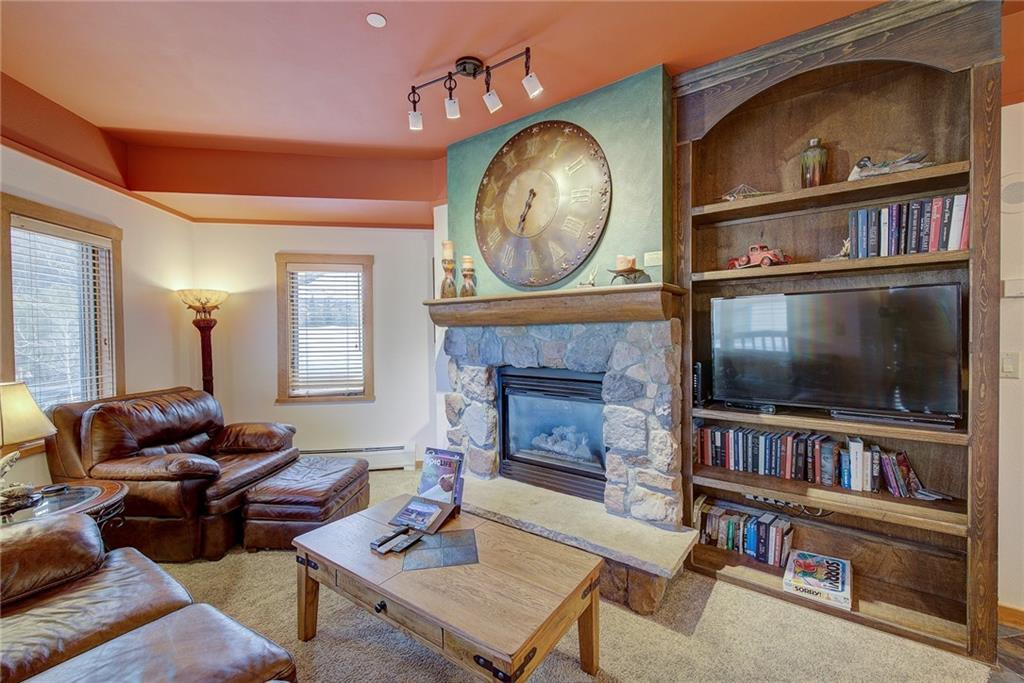 Beautiful fireplace and custom built in cabinet houses flat screen TV and electronics