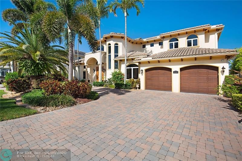 This exquisite custom home has been re-imagined with no expense spared. Located on 90' of deep water frontage on prestigious Intracoastal Drive in Lighthouse Point. Upon entering the grand foyer you experience light-filled open rooms facing the pool and waterway.The elegant first floor master suite has a luxurious bath & his/hers wardrobes. Featured is a new gourmet kitchen with SS appliances, gas cooktop and just what everyone is looking for in the perfect kitchen for today.The second floor includes 3 additional bedrooms and open den. Located just off the south grand canal and across from the intra-coastal so close to the Hillsboro inlet.Outdoor entertainment is enjoyed at resort style pool, spill over spa & covered loggia. Please see the attachments for the long list of improvements